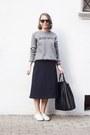 Black-celine-bag-black-ray-ban-sunglasses-navy-cos-skirt
