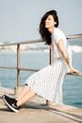 White-uniqlo-t-shirt-white-ezzentric-topz-skirt-black-nike-sneakers