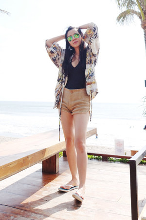 Art of Lila shorts - ray-ban sunglasses - nun bangkok swimwear