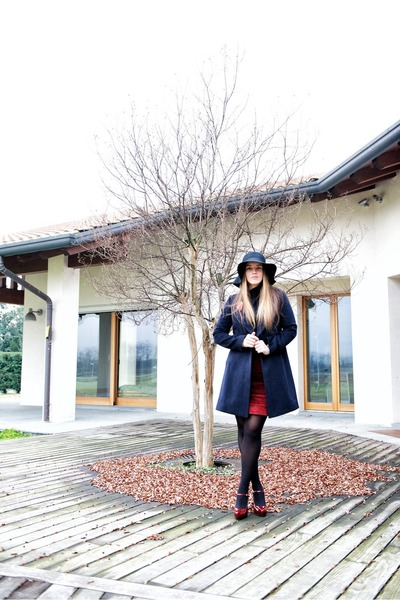 black gazel coat - black gazel hat - maroon gianna meliani heels