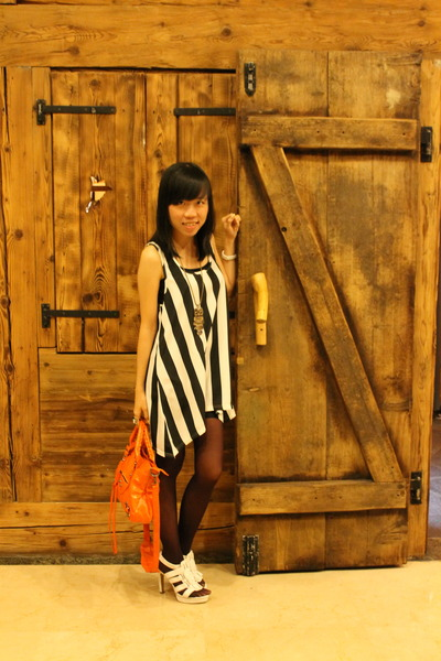 black Gaudi dress - carrot orange balenciaga bag - white Charles & Keith heels