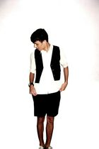 green pool shirt - black Rutra vest - black pool shorts - gold Converse shoes -