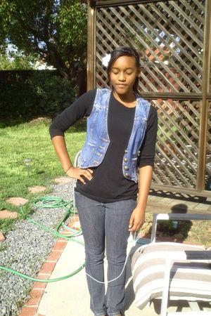 blue vest - gray jeans - black sweater