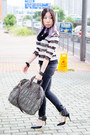 Black-levis-jeans-olive-green-prada-bag-black-truth-or-dare-by-madonna-heels