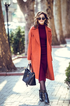 burnt orange coat - black bag