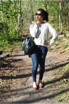 navy skinny Levis jeans - dark green leather Anthropologie bag