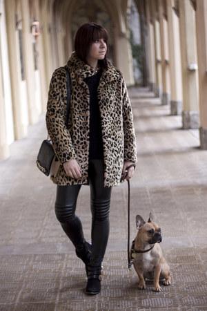 dark brown New Yorker coat