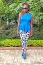 Black-letter-printed-mrprice-leggings-ruby-red-clutch-bag-blue-suede-heels