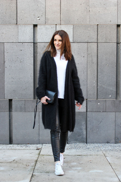 black cos cardigan white converse shoes black hum pants