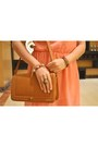Bronze-satchel-queen-street-bag-peach-mullet-dress