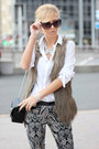 White-shirt-black-bag-black-pants-light-brown-vest-white-necklace
